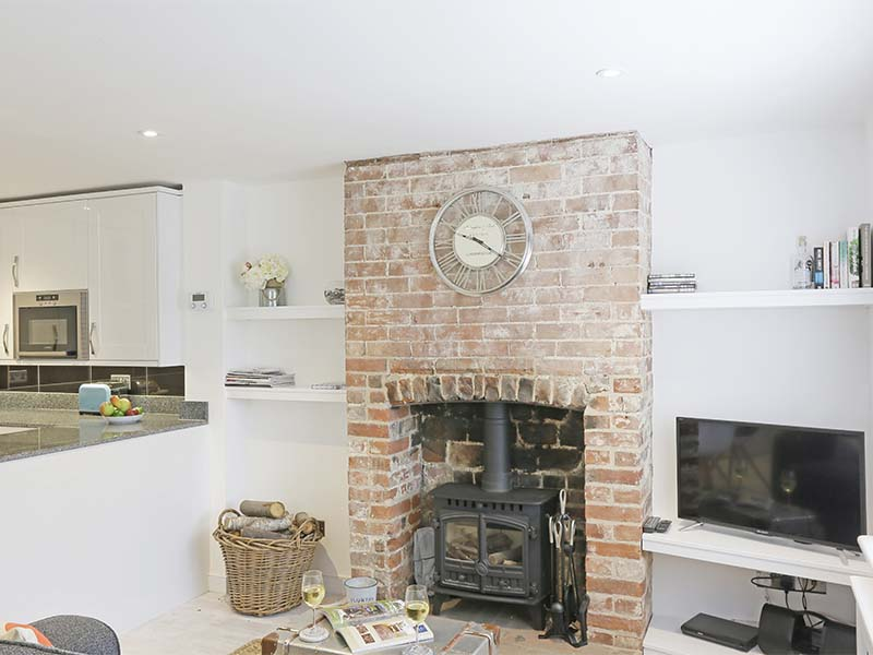 Wood burner with exposed brick fire place