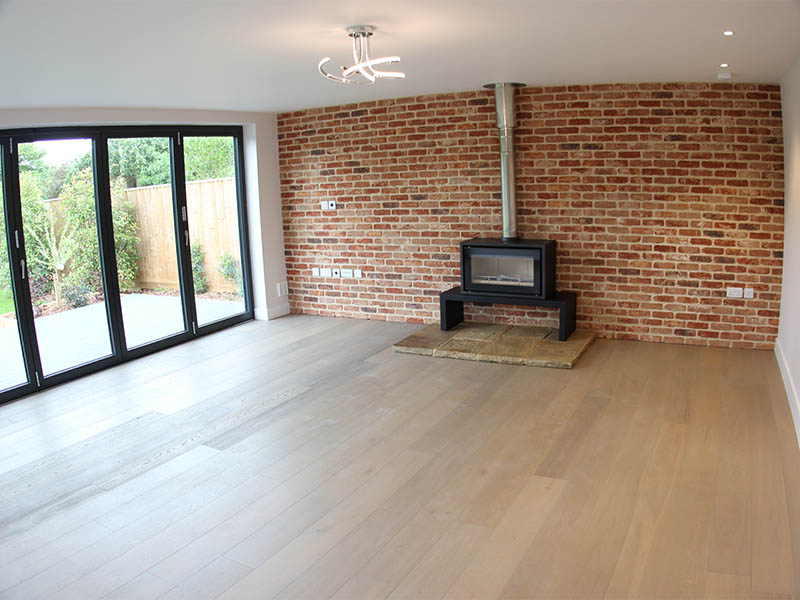 Exposed brick wall with wood burner