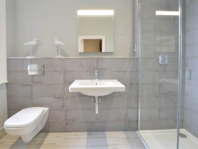 The Terrace bathroom with grey tiles
