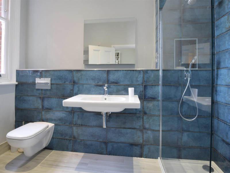 The Terrace bathroom with blue tiles